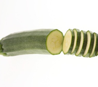 sliced zucchini on white background