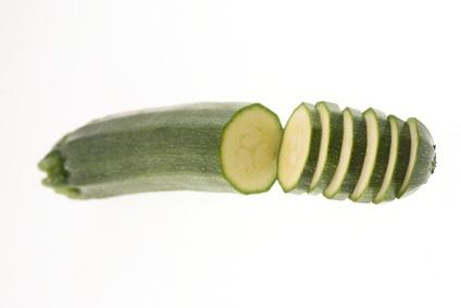 sliced zucchini on white background